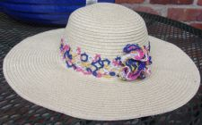 tan hat with Broadband and flower